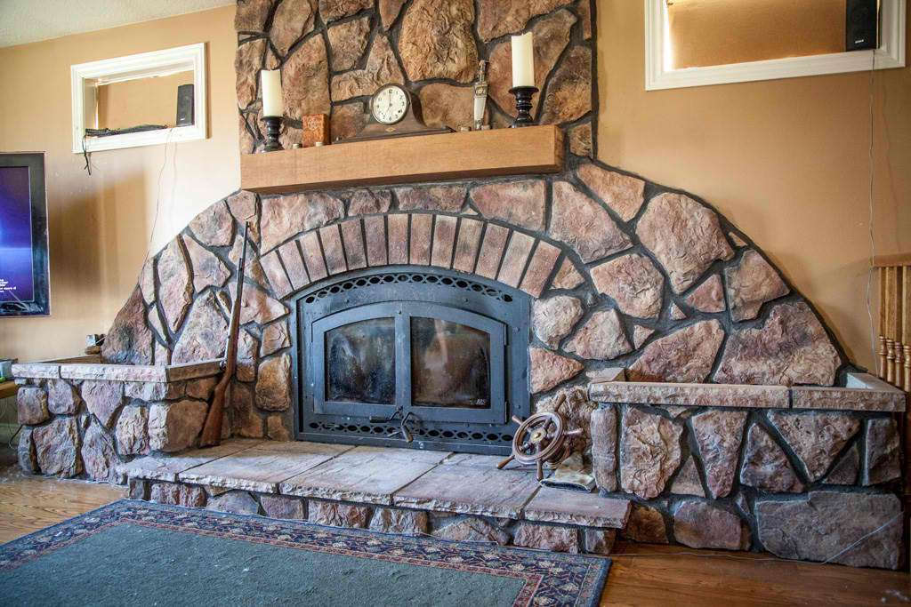 fireplace with concrete textured design