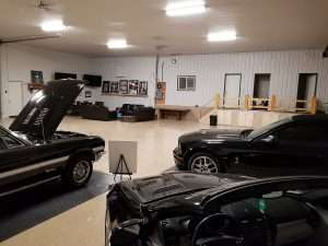 low ceiling garage flooring with black cars